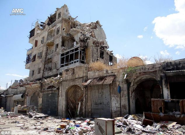 Destruction: Homes are seen destroyed by Syrian government airstrikes and shelling in Aleppo, Syria