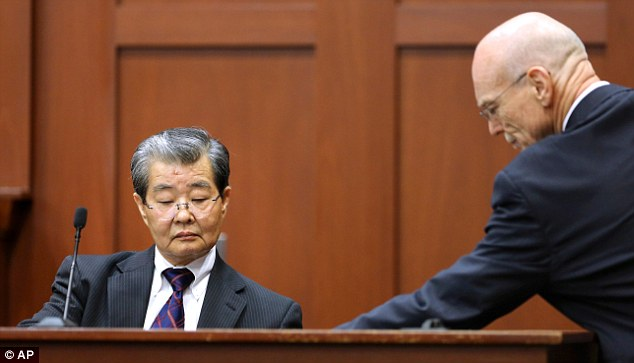 Making a point: George Zimmerman's defense attorney Don West, right, presents state witness Dr Hirotaka Nakasone, left, a senior voice recognition scientist with the FBI, with a marked exhibit