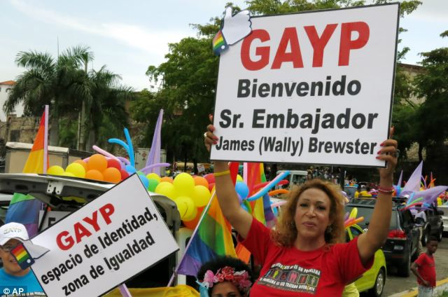 Gay Pride marchers in Santo Domingo held signs on Sunday reading (R) 'Welcome Mr. Ambassador James
