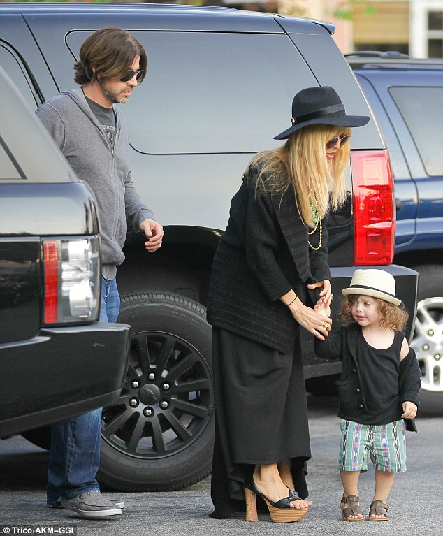 Fashion faux-pas: Rachel Zoe squeezed her feet into black platform heels, which were clearly two sizes too small in Malibu Monday