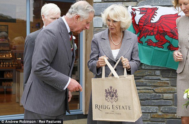 What's in there? The Prince of Wales inspects the contents of his wife's Rhug Estate shopping bag