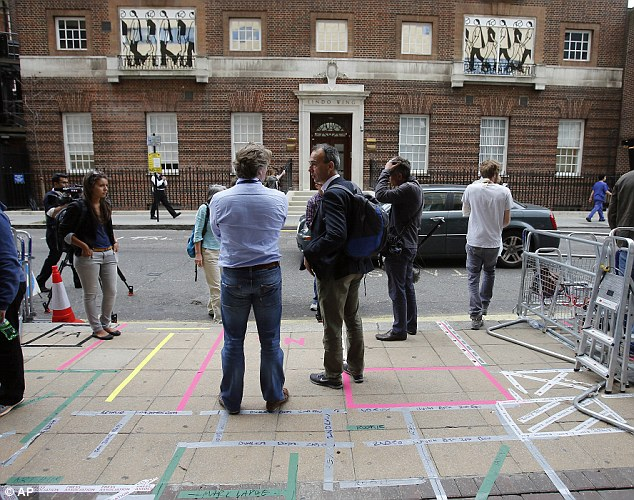 Preparation: Photographers and journalists stake out their positions ahead of the royal birth at St. Mary's