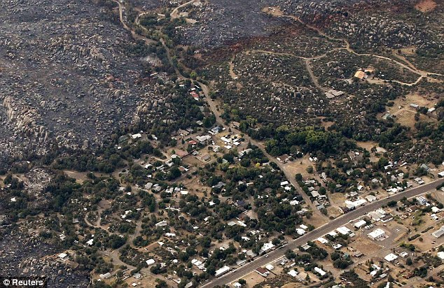 Charred: The helicopter images show the area where an elite squad of 19 Arizona firemen was killed