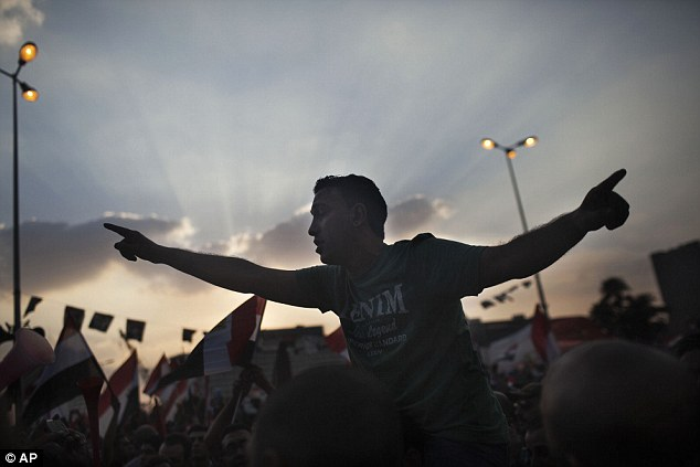 Protesters chants slogans against President Mohammed Morsi during a rally in Tahrir Square yesterday