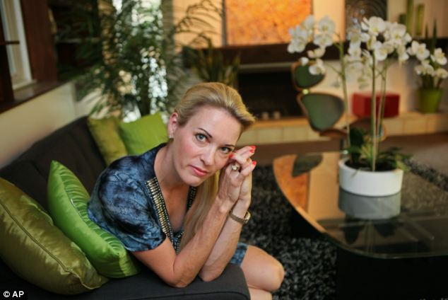 Shamed: Suzy Favor Hamilton, pictured in July last year, was exposed as an escort last year and her name has now been dropped from the Big Ten Suzy Favor Athlete of the Year award