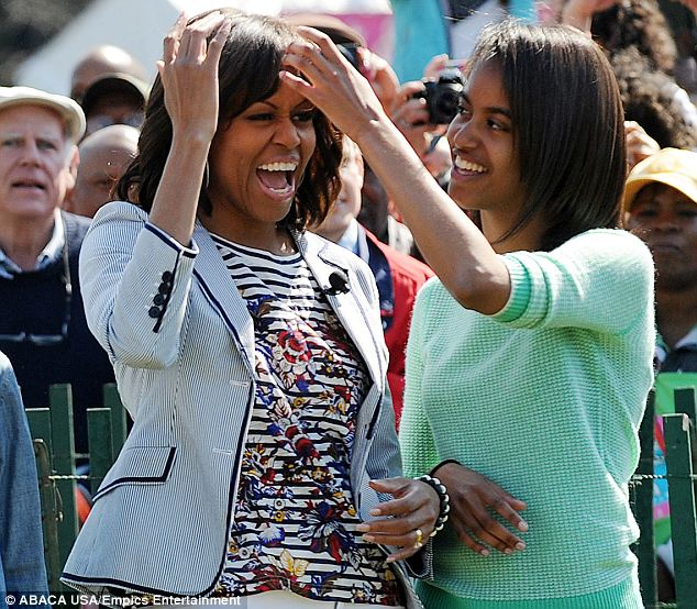 Stylist-in-chief: Malia affectionately smooths her mother's bangs