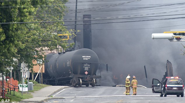 Derailment: Smoke is still filling the streets around where the 73-car freight train derailed