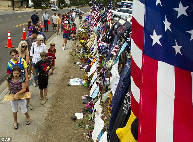 A community mourns: Grief reigned at the Fire Station No. 7 in Prescott, Arizona as they remember the 19 Granite Mountain Hotshot firefighters killed in a June 30 fires