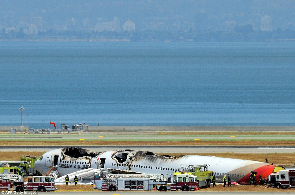 Horror: The Asiana Airlines Boeing 777 crash landed just off the runway at San Francisco International Airport on Saturday morning, killing two passengers and injuring more than 180
