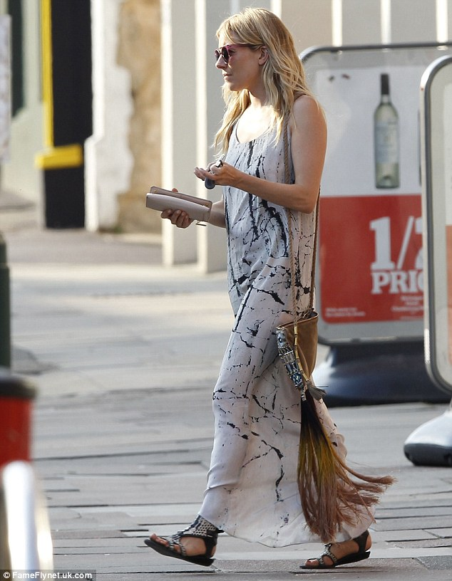 Day off: She matched her dress with a tassel bag and gladiator sandals for the outing