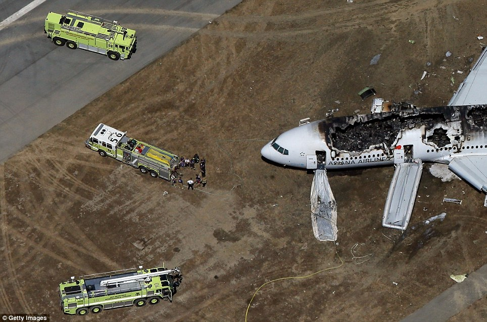 The Boeing 777 airplane lies burned near the runway after it crash-landed at San Francisco International Airport July 6, 2013 in San Francisco, California
