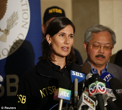 Investigation: Deborah Hersman, Chairman of National Transportation Safety Board (NTSB) speaks as San Francisco Mayor Ed Lee stands beside, during a news conference at San Francisco International Airport on July 7, 2013
