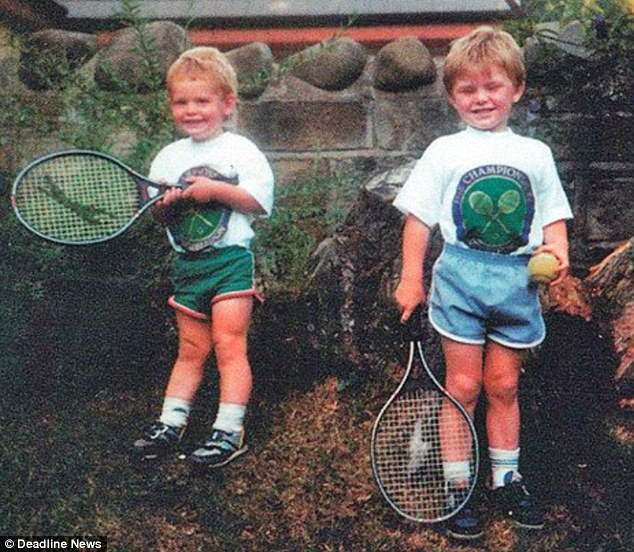 Andy (left) with older brother Jamie - who also plays professionally - in Wimbledon T-shirts