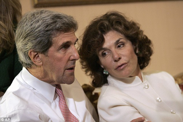 John Kerry, left, talks with his wife Teresa Heinz Kerry while watching election results at a hotel in Boston on Tuesday, November 4, 2008
