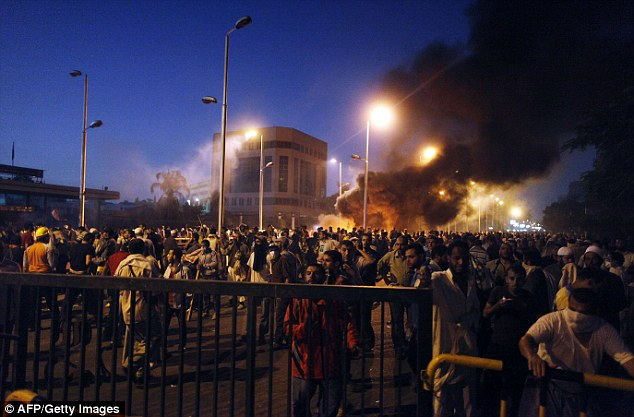 Smoke alarm: Egyptian supporters of the Muslim Brotherhood rallying in support of deposed president Mohamed Morsi clash with police outside the Republican Guard HQ in Cairo
