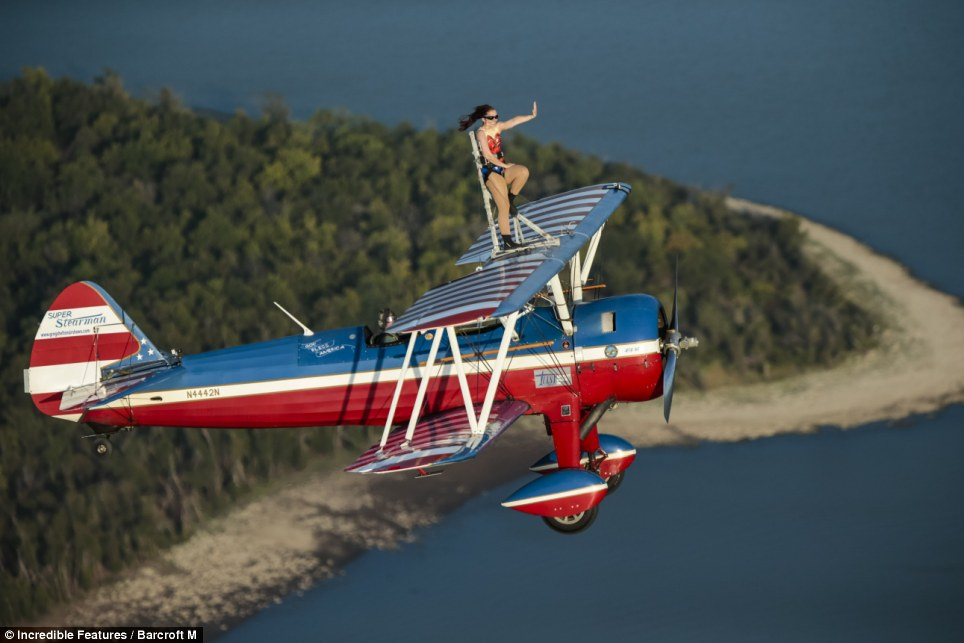 Wonder woman: Ashley Battles braves the winds as she does an Americana-style wing walk in Collinville, Oklahoma
