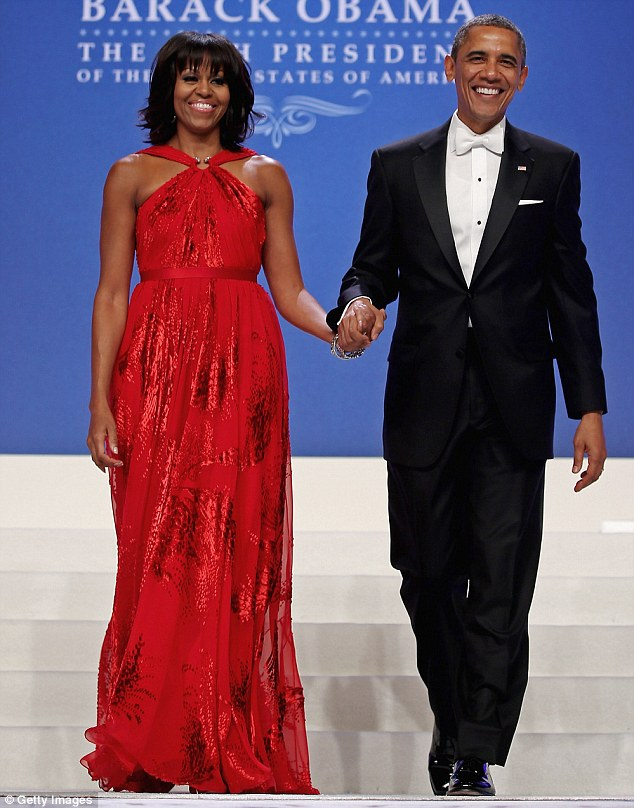 Handsome couple: President Obama with his wife Michelle at his second term inaugural party in Washington D.C., in January