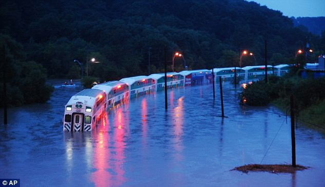 Stuck: This GO Train with around 1,000 passengers on board got stuck on the tracks after flash floods in Toronto