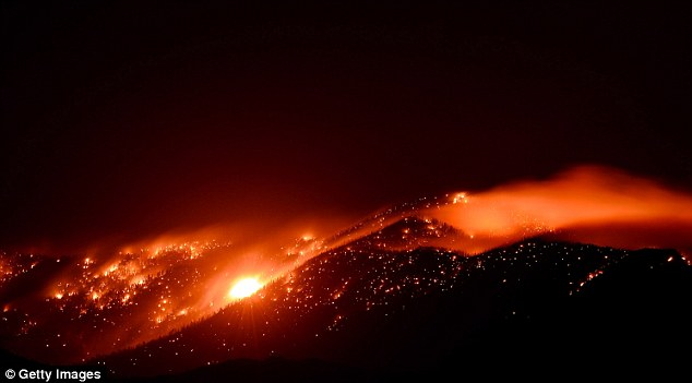 Spark: More than 9,000 acres of woodland has burned since lightning sparked the blaze in Carpenter Canyon on the Pahrump, Nevada side of Mount Charleston on July 1