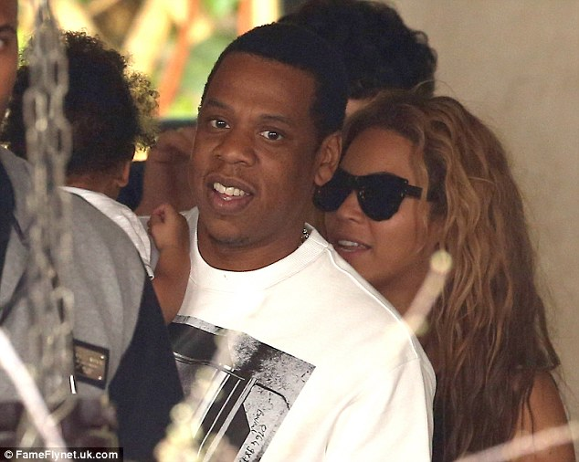 Hip-hop royalty: Jay-Z and Beyonce with their daughter Blue Ivy Carter, who will be 23rd cousins twice-removed with Kate and William's baby, according to researchers