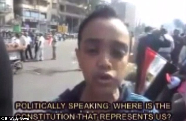Speaking with authority: Ali Ahmed, aged 12, makes some insightful remarks to a TV station about the state of his country
