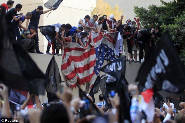 Not just Benghazi: Protesters destroyed an American flag pulled down from the U.S. embassy in Cairo on the same day the Benghazi consulate fell