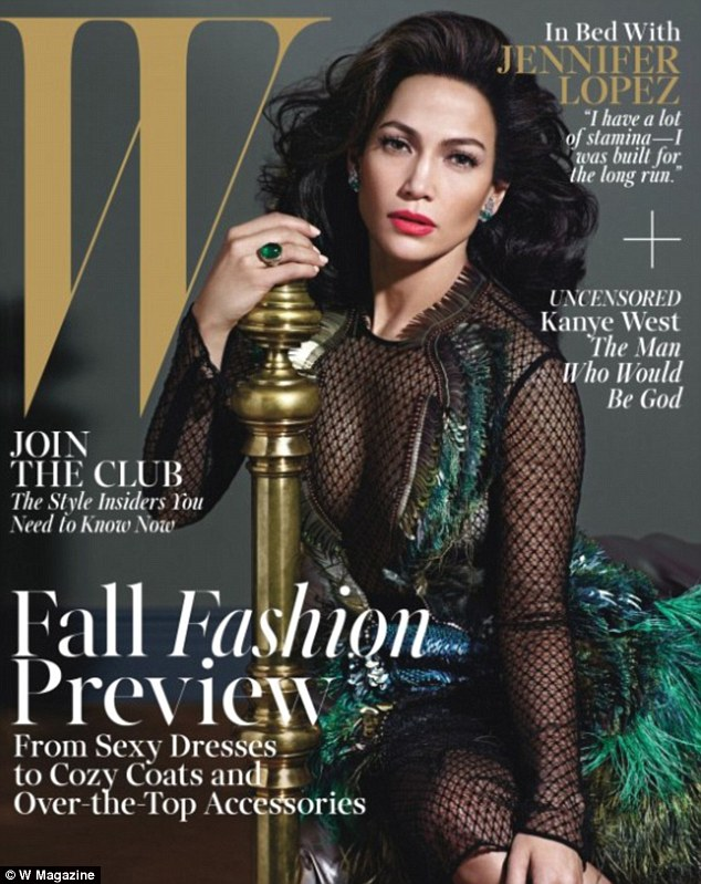 Cover girl: Jennifer Lopez graces the front cover of the August edition of W Magazine wearing a sheer black lace dress adorned with peacock-style feathers