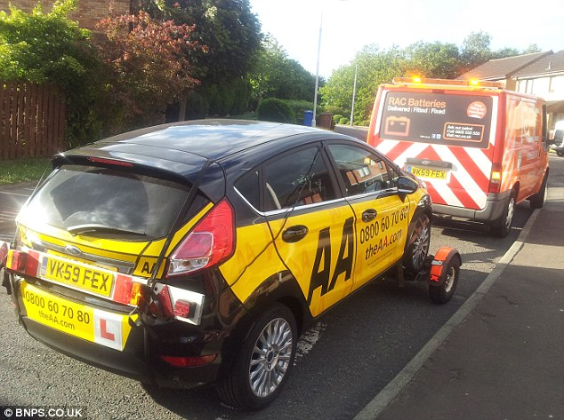 Stricken: The AA Driving School motor suffered a puncture while on a driving lesson and was left stranded because the car didn't have a spare wheel