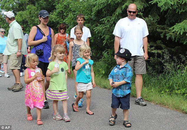 On the campaign trail: Bobby leads children and adults on a walk to raise money for Ronald McDonald House Charities of the Red River Valley