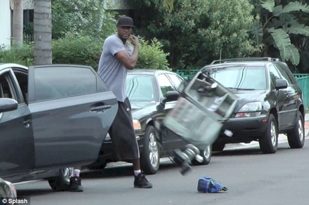 Making a scene: Lamar Odom was seen losing his temper with photographers on Wednesday in Los Angeles