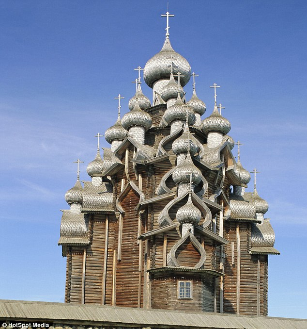 Stunning: Bathed in the sun, the aged wooden domes of the incredible church look silver and decadent
