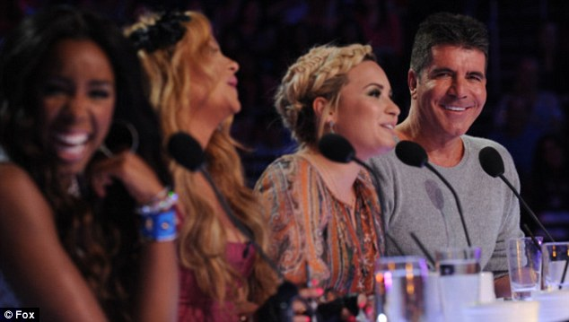 Simon Cowell admires his fellow judges Kelly Rowland, Paulina Rubio andDemi Lovato at X Factor auditions in LA on Wednesday