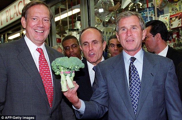 Partisan warfare: Then-Texas Governor George W Bush posed with a head of broccoli during a 1999 campaign stop in the Bronx