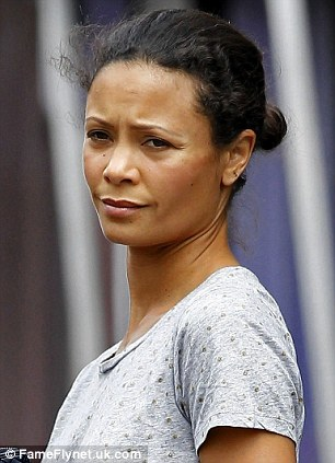 Caught unaware: Even smiley celebrities like Katie Holmes and Thandie Newton suffer from Bitchy Resting Face, which can make a person look sour when they're actually perfectly happy