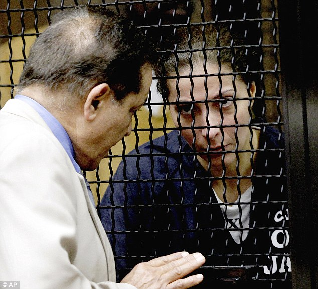 Behind Bars: Saudi princess Meshael Alayban, (right), listens to an interpreter during her scheduled appearance in court Thursday July 11th, 2013 in Santa Ana, California today