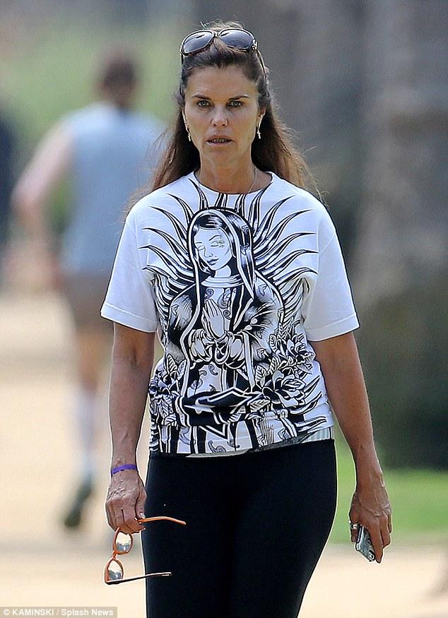 Virtuous Maria Shriver wears a religious Tshirt while