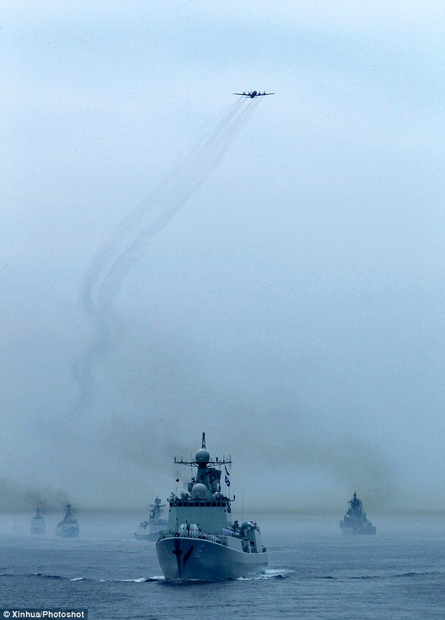 Allies: Chinese and Russian naval vessels are seen during a military review of the