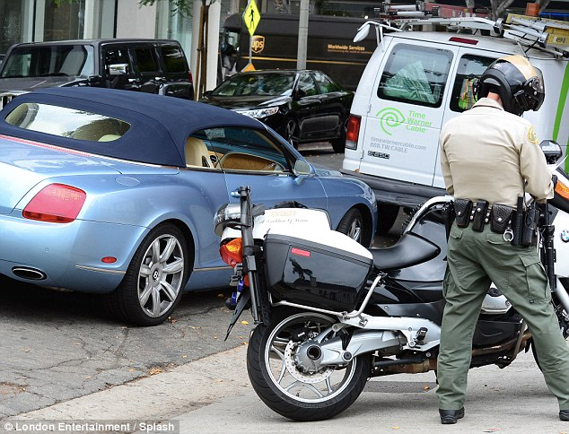 Busted: Paris pulls over in her customized Bentley for a motorbike cop