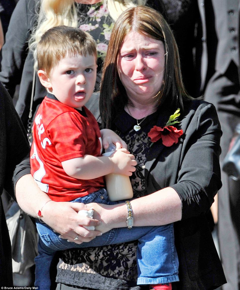 His wife Rebecca Rigby struggled to hold back her tears as she carried their son Jack and followed his coffin