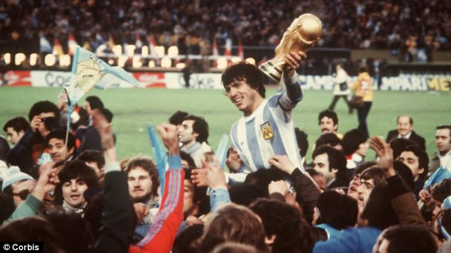 World Cup Glory: Argentina captain Daniel Passarella raises the World Cup Trophy as he is carried shoulder high by fans after Argentina beat Holland 3-1 in the 1978 World Cup Final on home soil