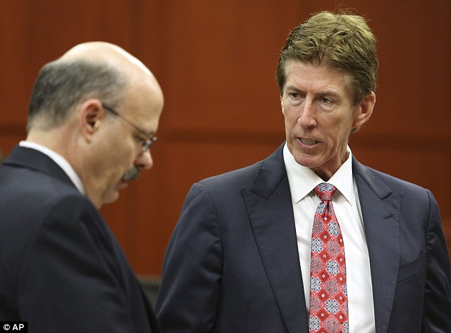Opposite sides: Defense counsel Mark O'Mara, left, talks to prosecutor Bernie de la Rionda, right. Both men gave the closing arguments in Zimmerman's trial