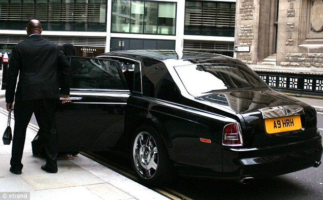 In the dock: Sarah Al Amoudi, 30, leaves London's High Court surrounded by minders in a Rolls Royce with an 'HRH' number plate