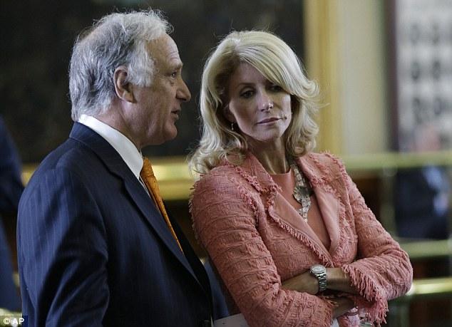 On the floor: Democrats Kirk Watson and Wendy Davis discuss progress on the Bill on Friday