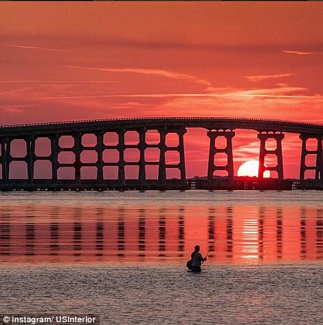 North Carolina: A fisherman on the Cape Hatteras National Seashore at sunset