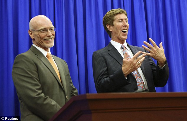 Victorious: Zimmerman's lawyers, Don West (L) and Mark O'Mara (R), address the media after winning the case
