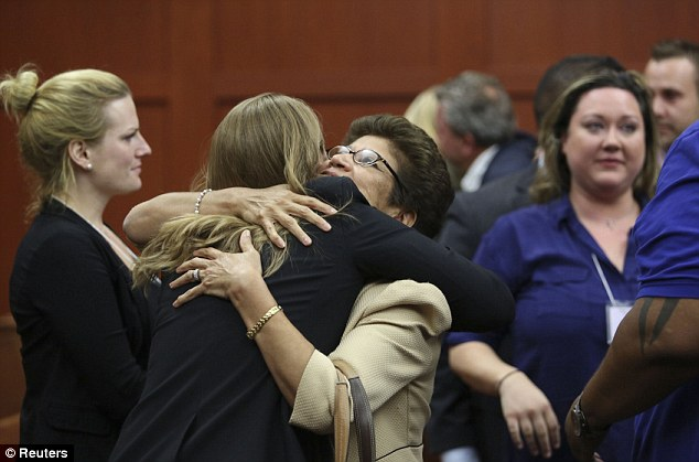 Relief: George Zimmerman's family celebrate as the jury clear him of all charges