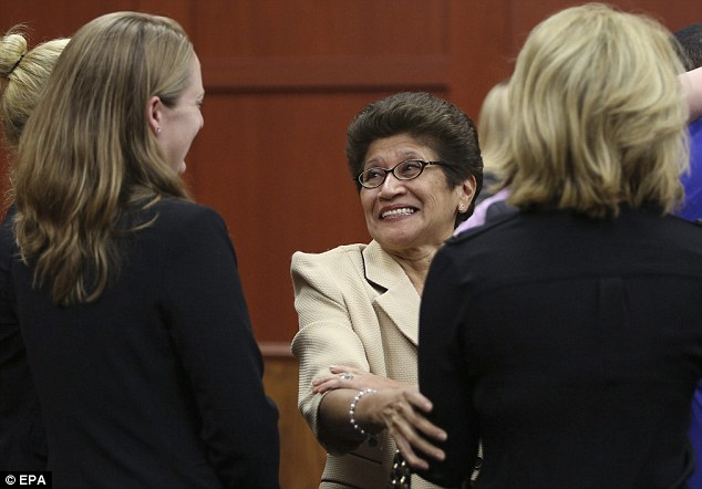 Joy: Gladys Zimmerman, center, smiles broadly as she learns that her son has been acquitted