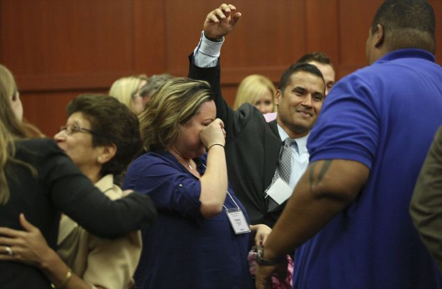 Emotional scenes: Zimmerman's family and legal team celebrate after the verdict was read out