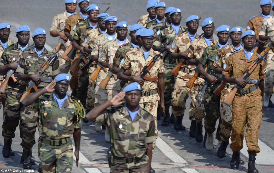 France honoured Malian troops on Bastille Day as they joined the parade along the Champs Elysees