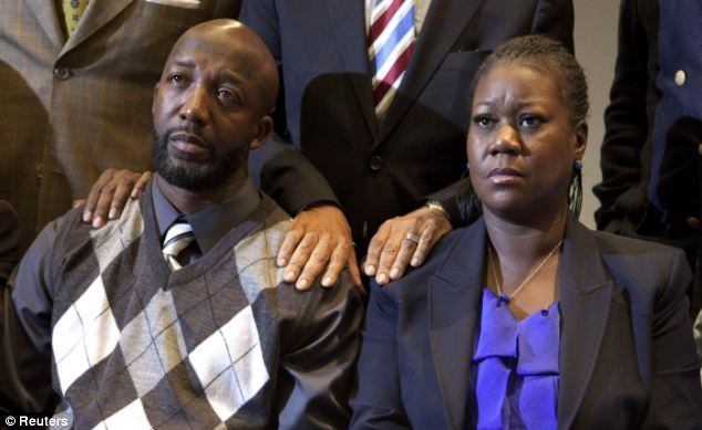 Following their lead: Obama urged Americans to respect the call for calm reflection from Trayvon Martin's parents, Tracy Martin and Sybrina Fulton